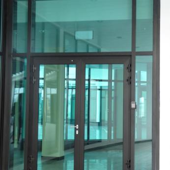 Curtain Wall System with Frameless Glazing